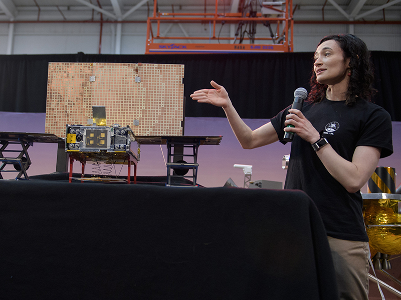 Annie Marinan, a Mars Cube One (MarCO) systems engineer with spacecraft model.
