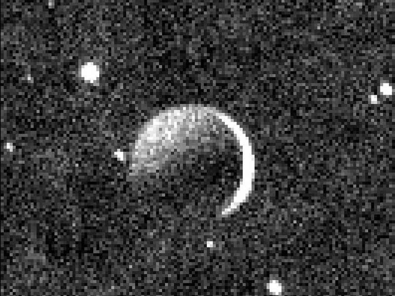 Black and white image of Charon with star field