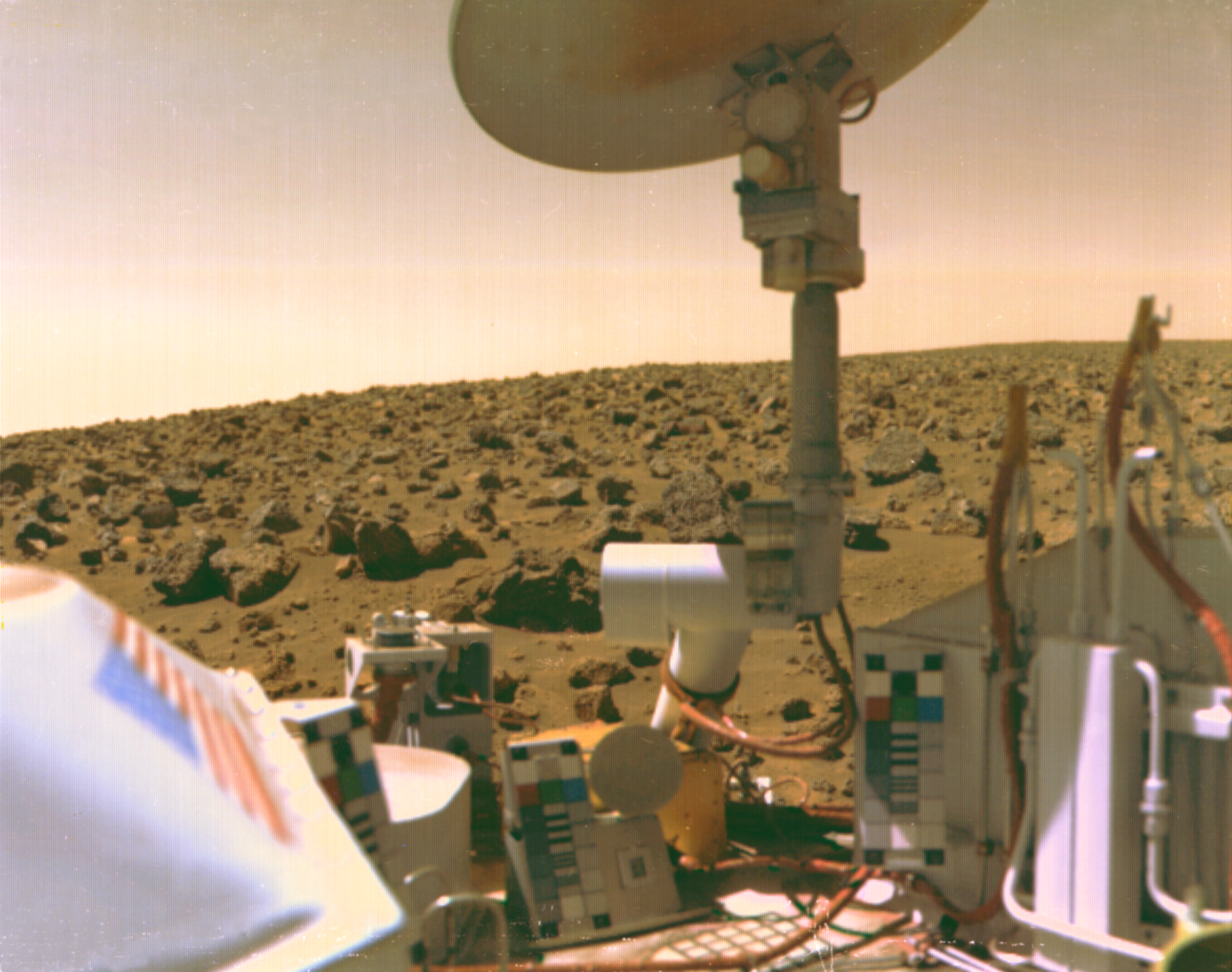 U.S. flag visible on Viking lander with Martian terrain on horizon