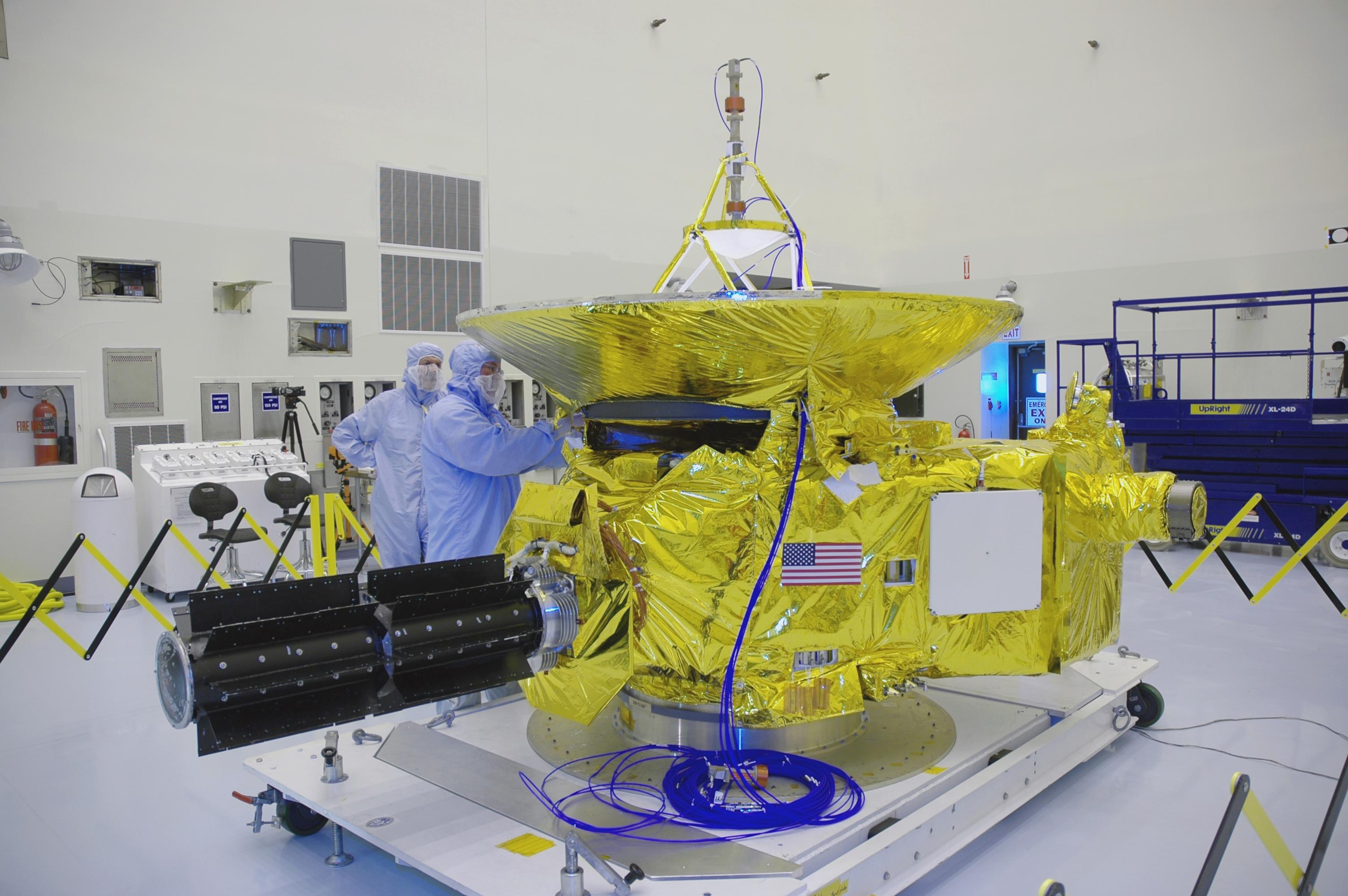 u.s. flag visible on spacecraft in clean room