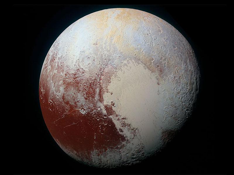 Color enhanced image of Pluto that shows a heart shape.