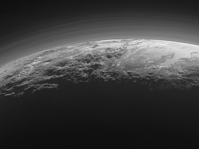 Mountains and haze over the limb of Pluto.