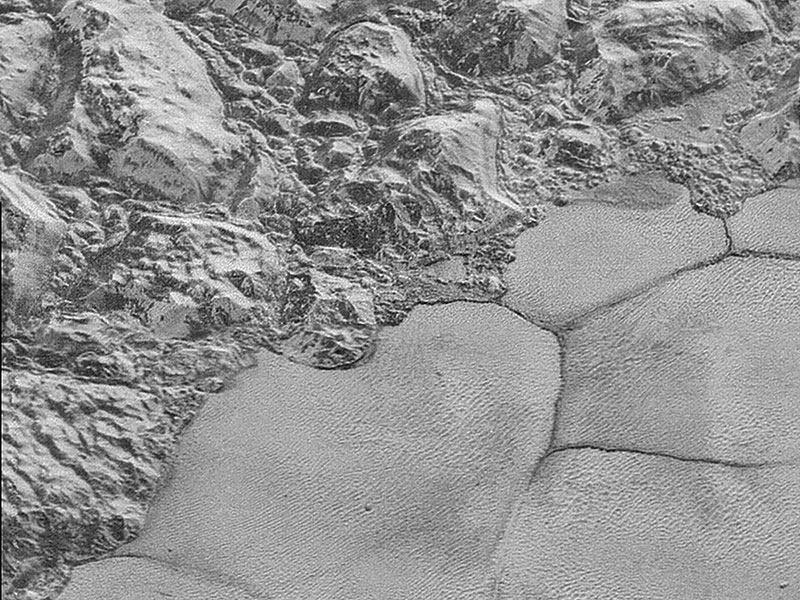 Close up of mountains and plains on Pluto.