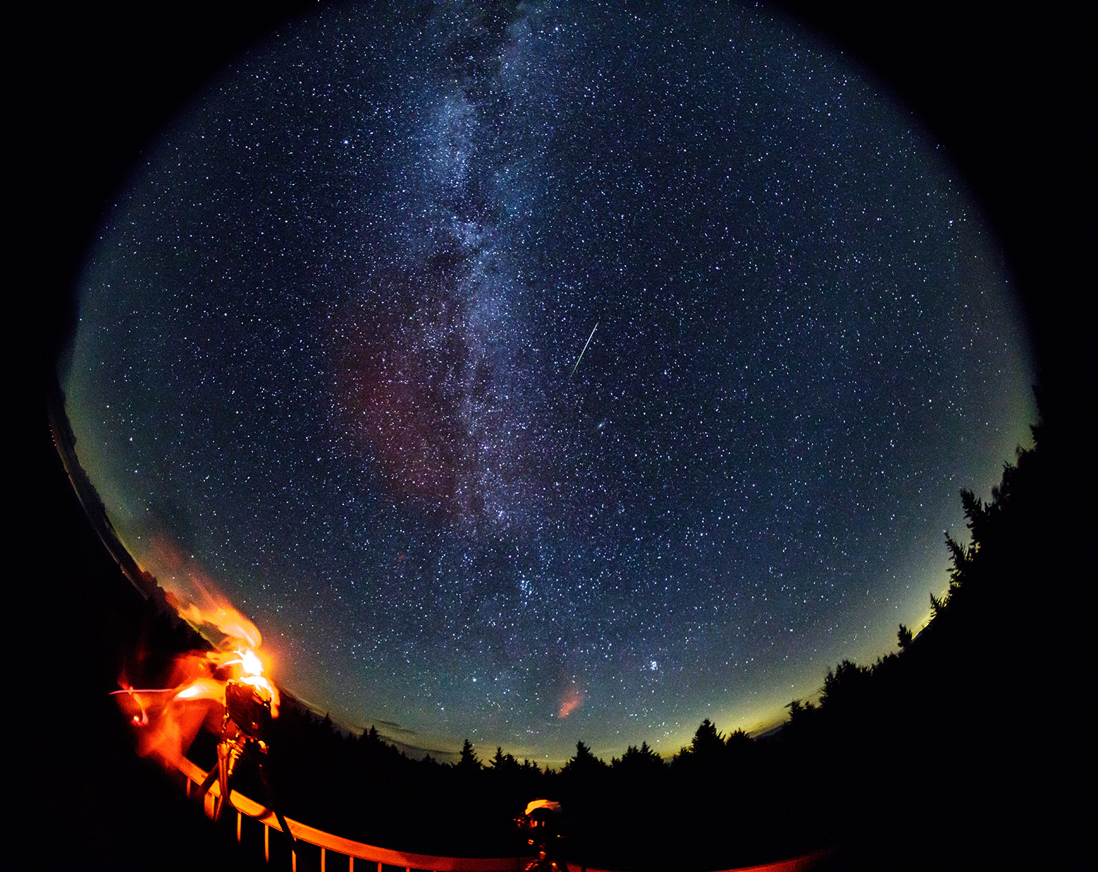 Meteor with Milky Way in the background.