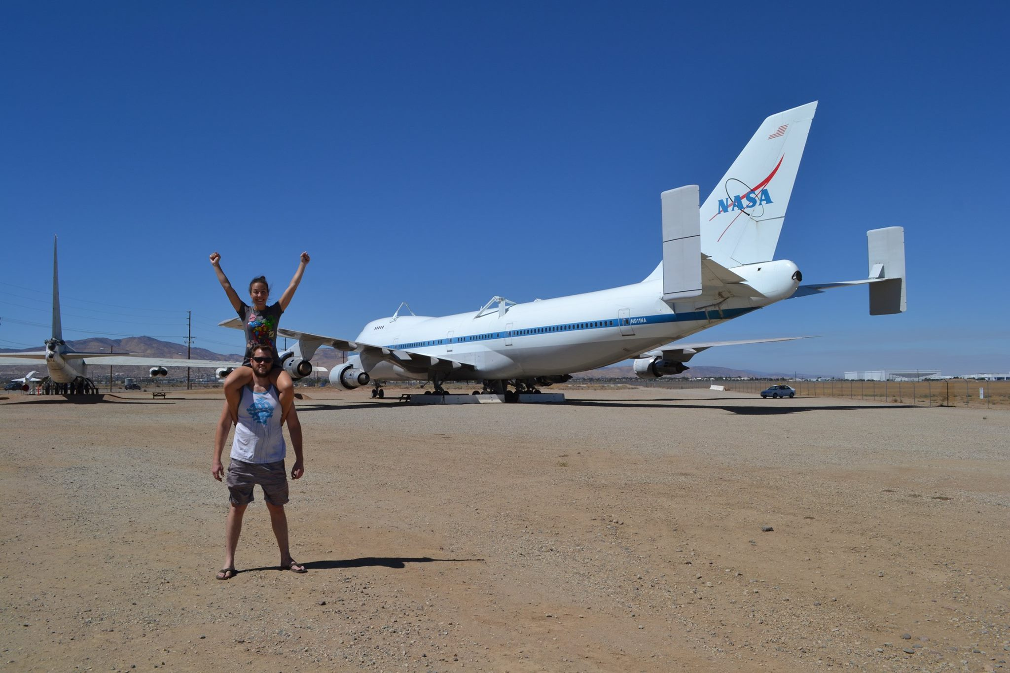 In front of a NASA shuttle carrier