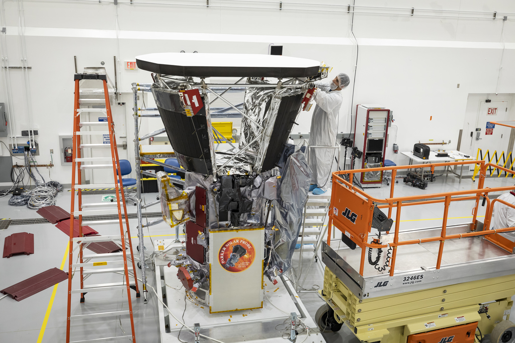 workers constructing spacecraft in clean room
