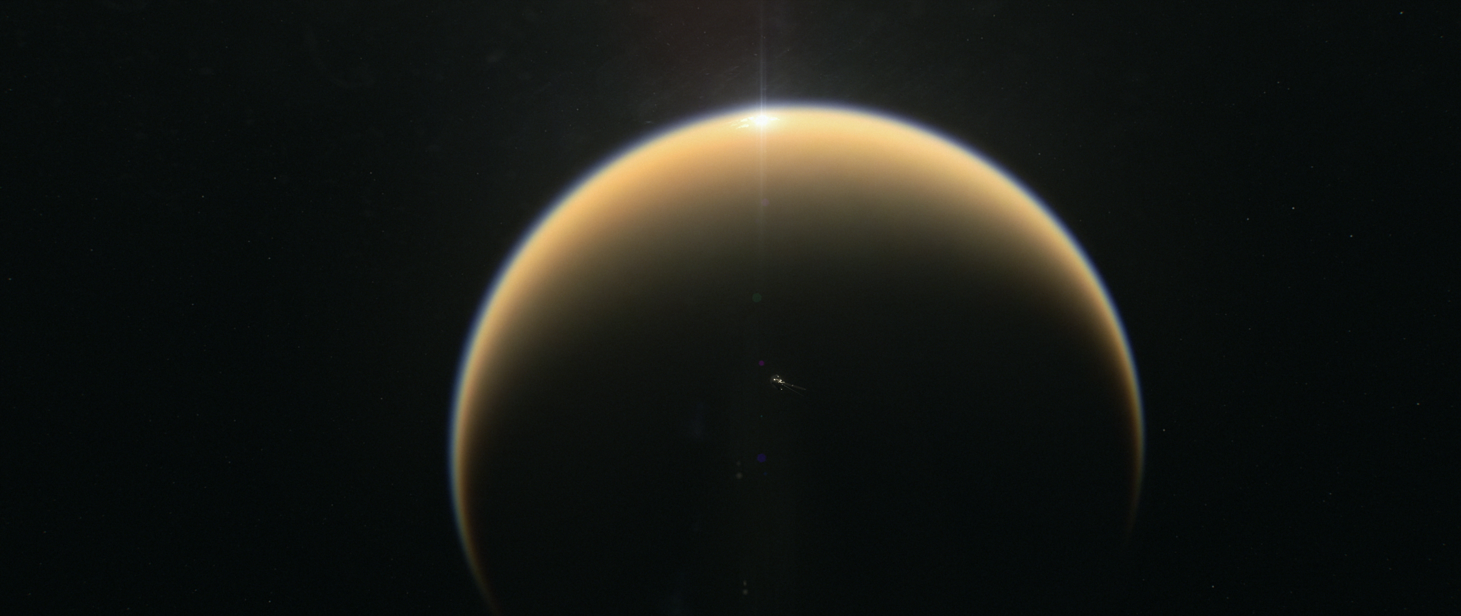 Illustration showings sunlight glint off the lakes of Titan.