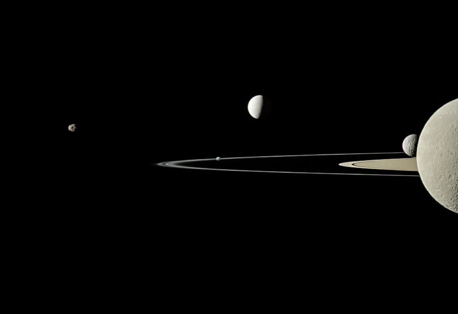 Five moons and Saturn's rings as seen from Cassini.