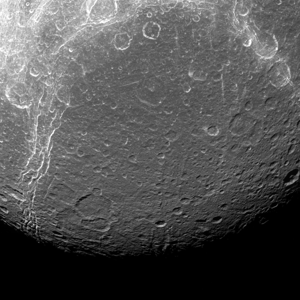 Black and white image of the surface of Dione.
