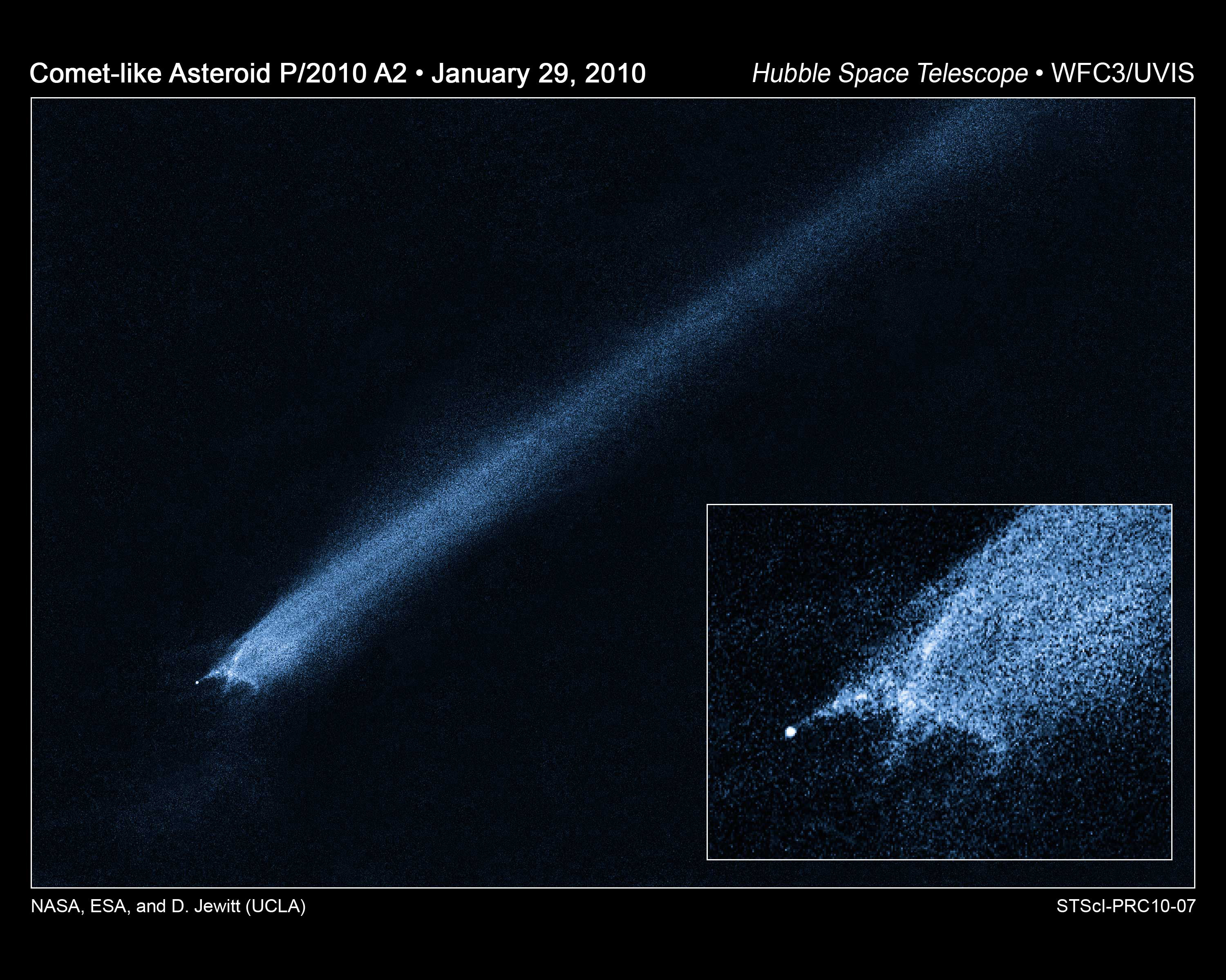 Image of asteroid trailing debris in space.