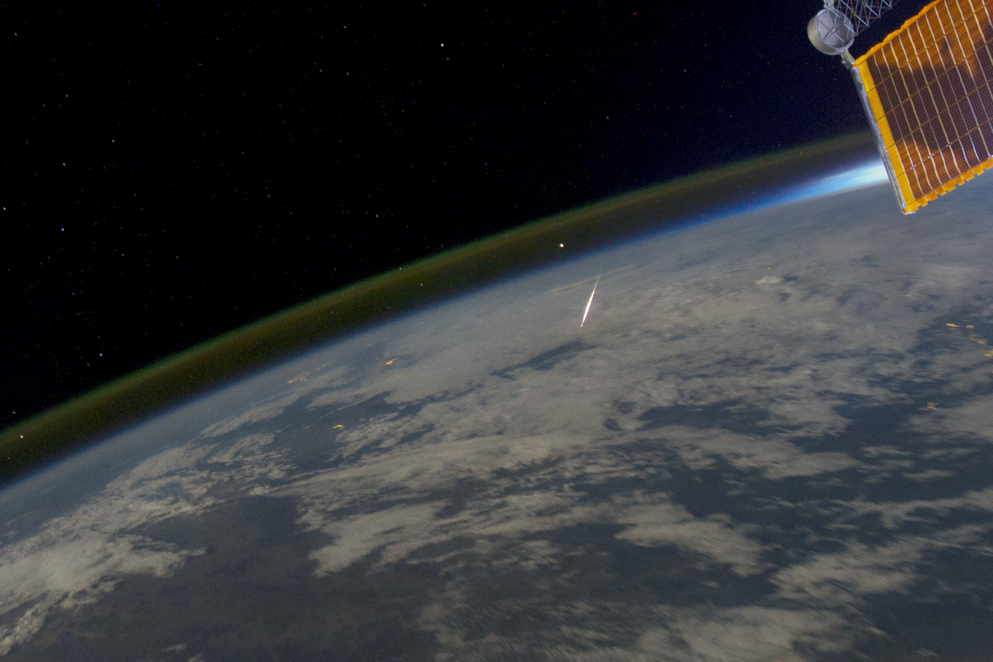bright streak above curved earth seen from above