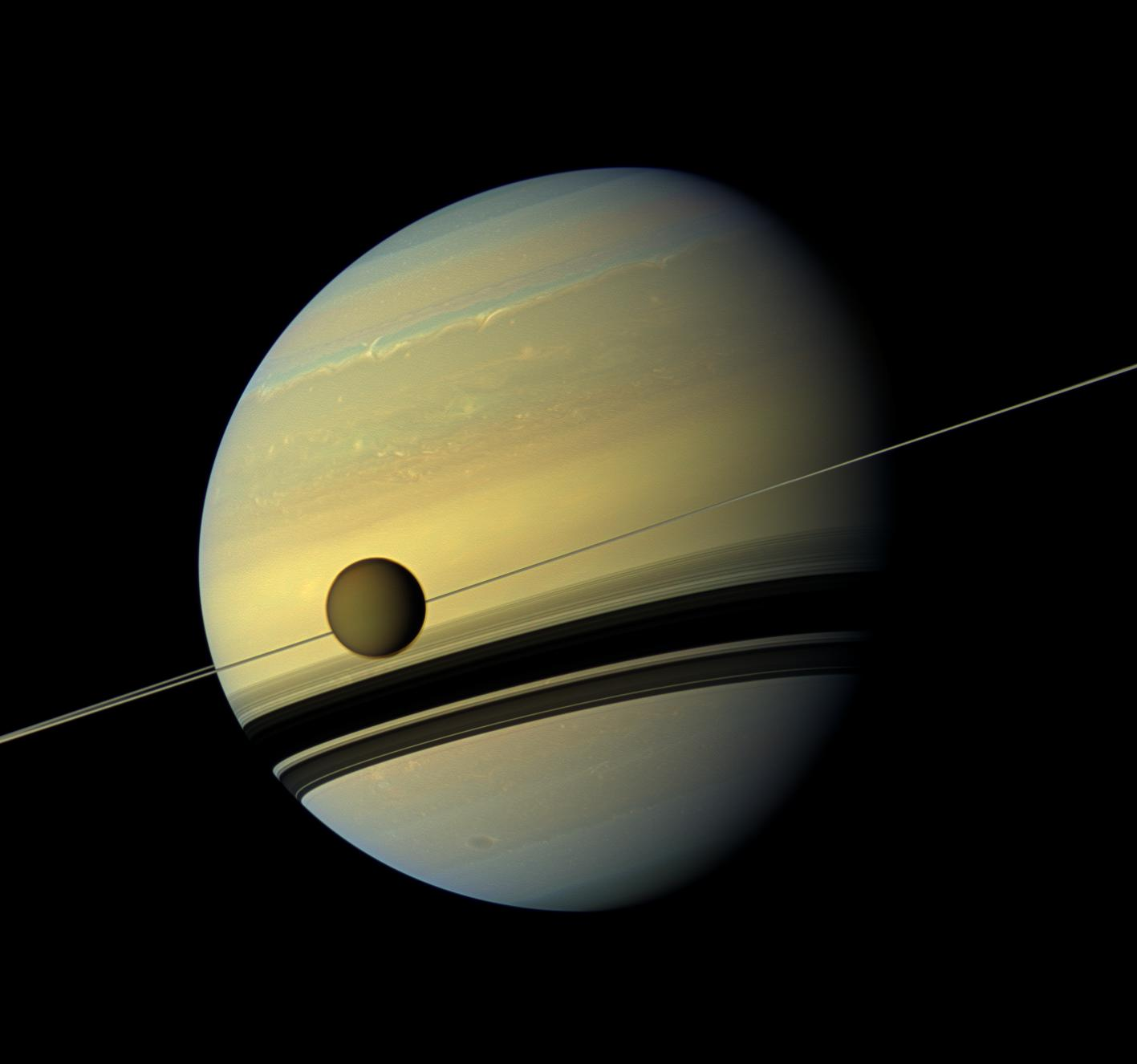 This Cassini image from 2012 shows Titan and its parent planet Saturn.