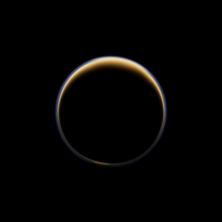 Sunlight scattering through the periphery of Titan's atmosphere forms a ring of color.