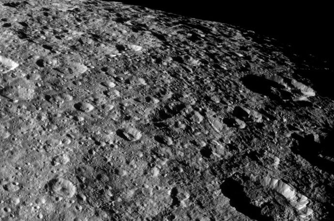Cassini took this image of the heavily cratered surface of Rhea