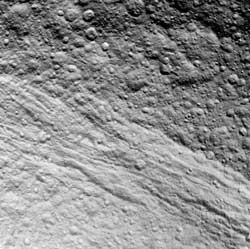 Tethys from approximately 37,196 miles (59,861 kilometers) away.