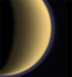 This false-color image shows a thin, detached haze layer (purple line) that appears to float above Titan's main atmospheric haze.