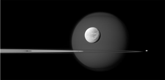 A quartet of Saturn's moons, from tiny to huge,