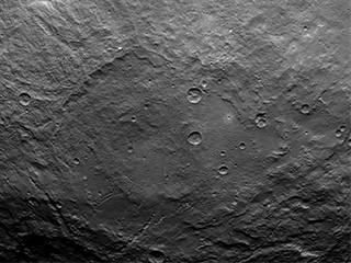 Dawn Survey Orbit Image 31 This image, taken by NASA's Dawn spacecraft, shows dwarf planet Ceres from an altitude of 2,700 miles (4,400 kilometers). The image, with a resolution of 1,400 feet (410 meters) per pixel, was taken on June 25, 2015.