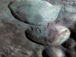 near-true color image of the remarkable snowman feature on asteroid Vesta's surface