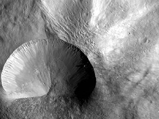 Layered young crater as imaged by NASA's Dawn spacecraft