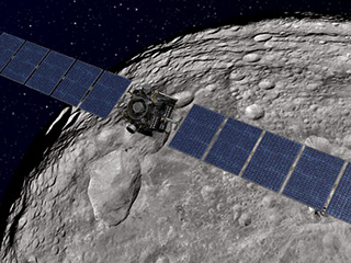 Artist's concept of the Dawn spacecraft soaring over the giant asteroid Vesta