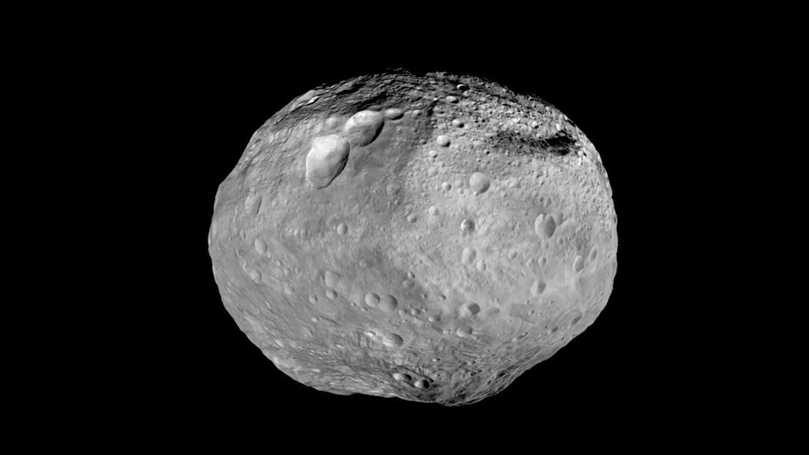Full disk view of roundish asteroid