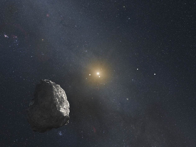 space rock and distant sun