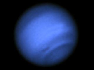 Fuzzy image of Neptune showing a dark spot