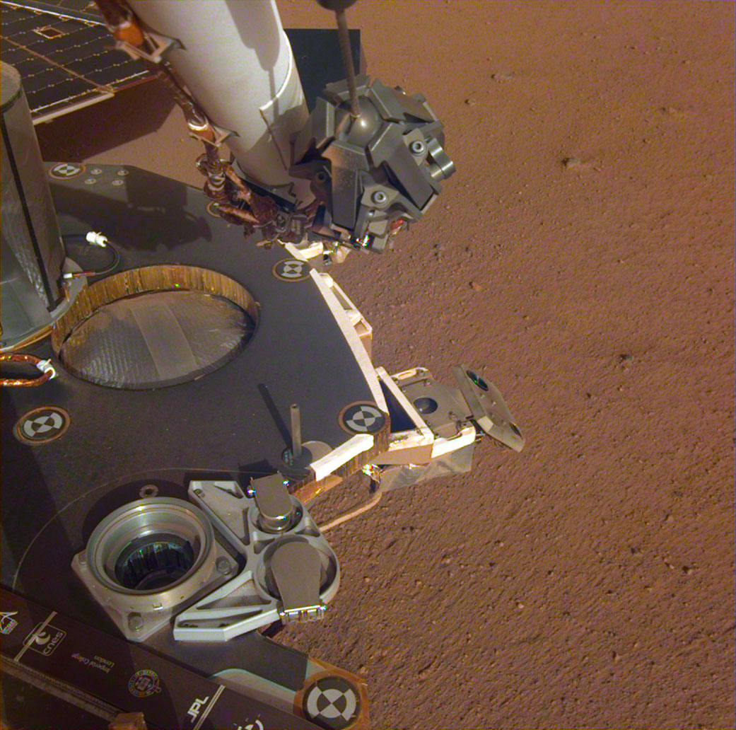 spacecraft hardware above Martian soil