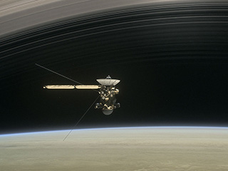 Artist's concept of Cassini diving between Saturn's rings.