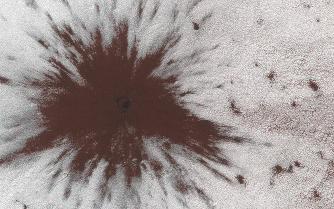 Fresh impact crater on Mars.