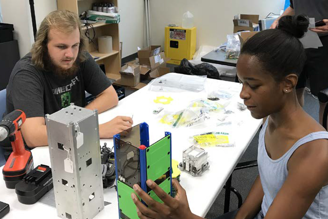 Two students with CubeSat