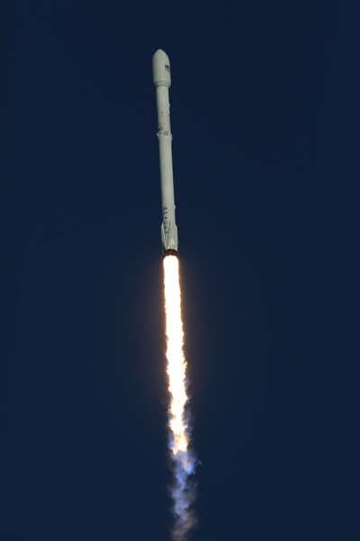 Rocket rising into space.