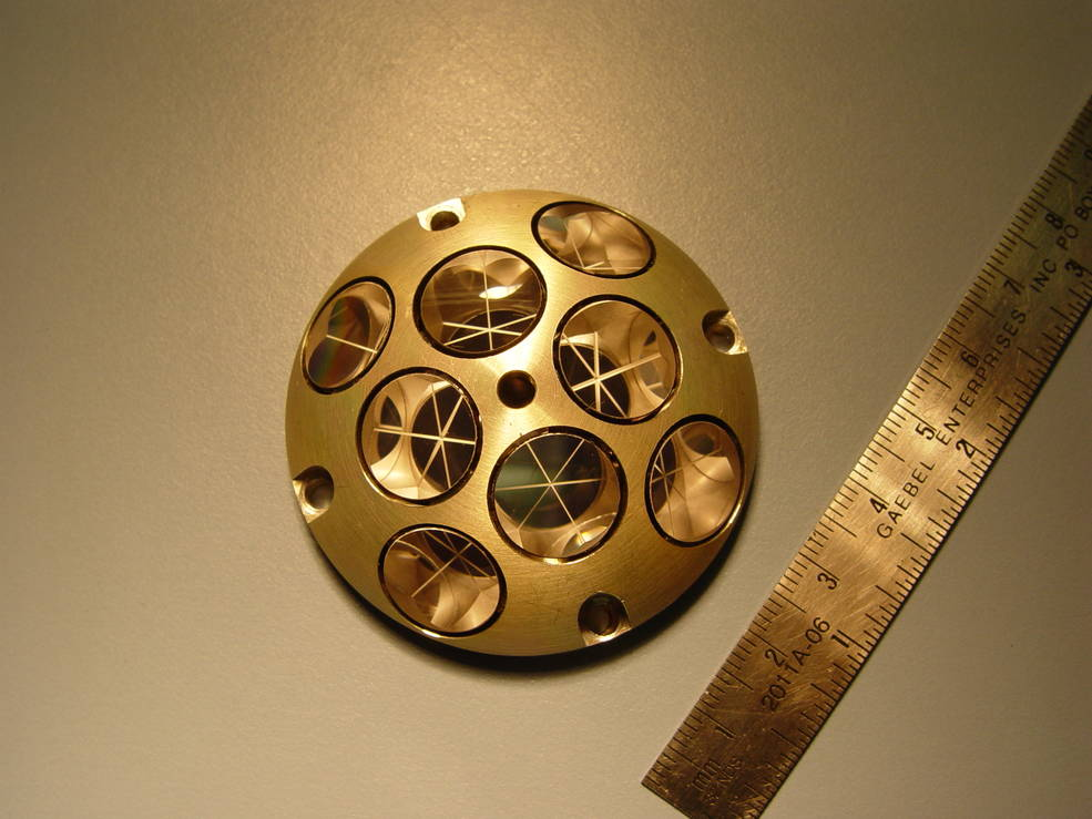 instrument with array of mirrors, pictured with ruler for scale