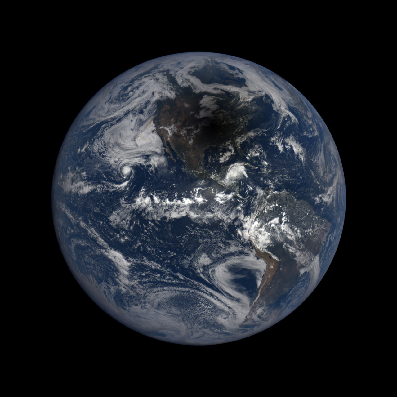 Full disk view of Earth with solar eclipse shadow visible over North America.