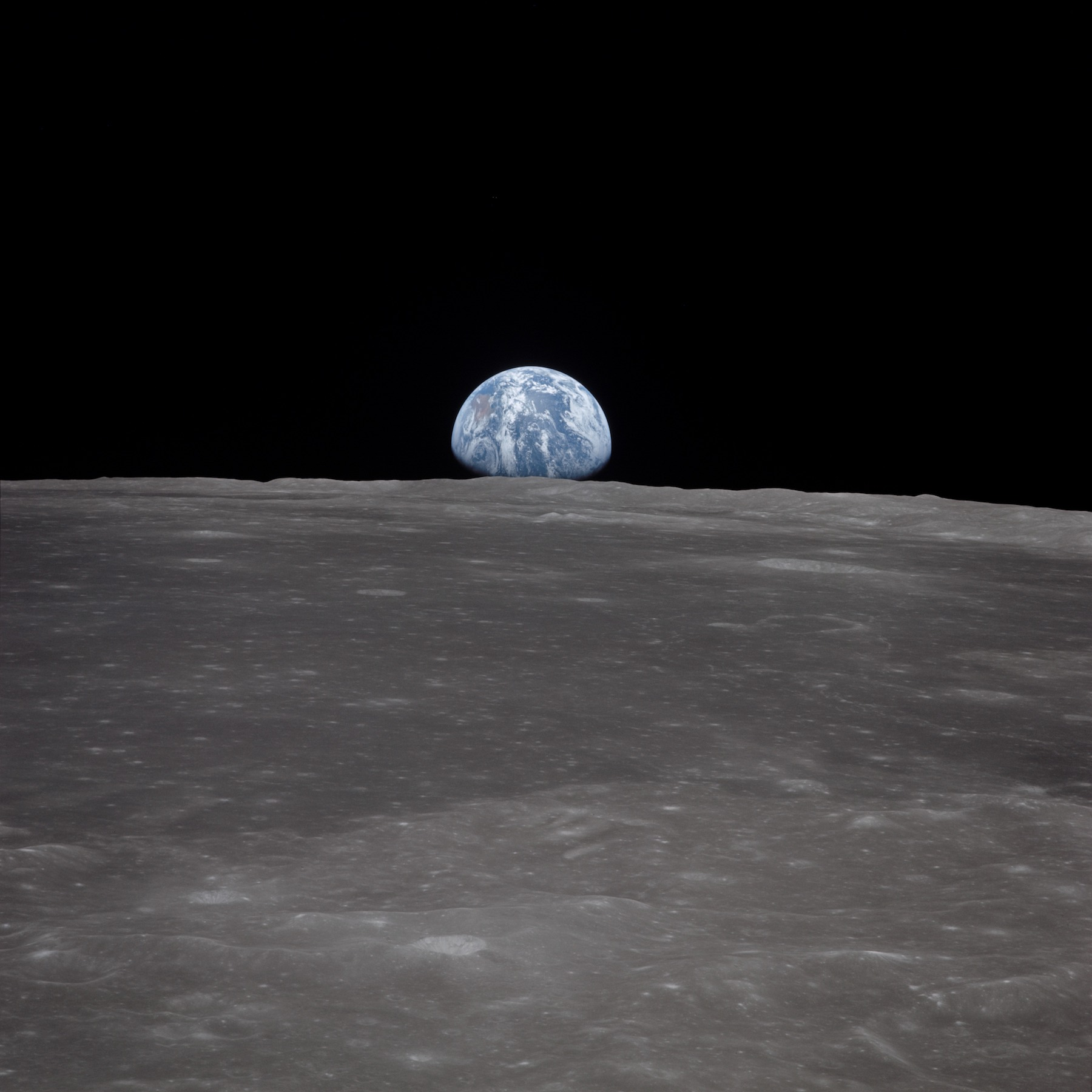 earth rising over lunar horizon