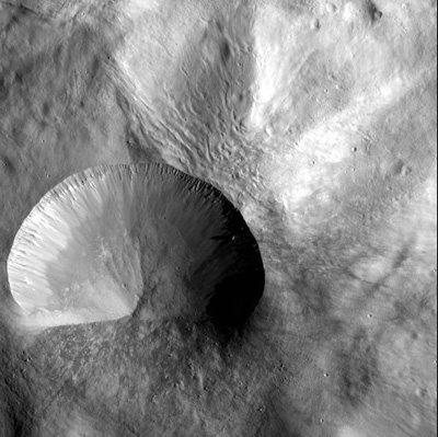 Sheer walls of impact crater on asteroid.