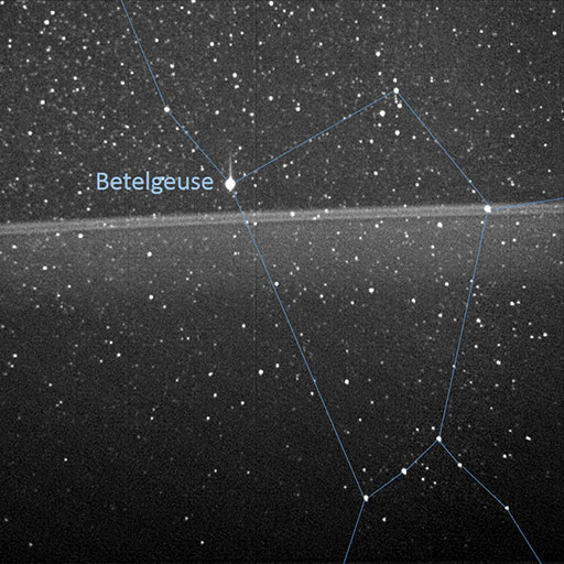 Jupiter's rings with Orion constellation and Betelgeuse labeled.