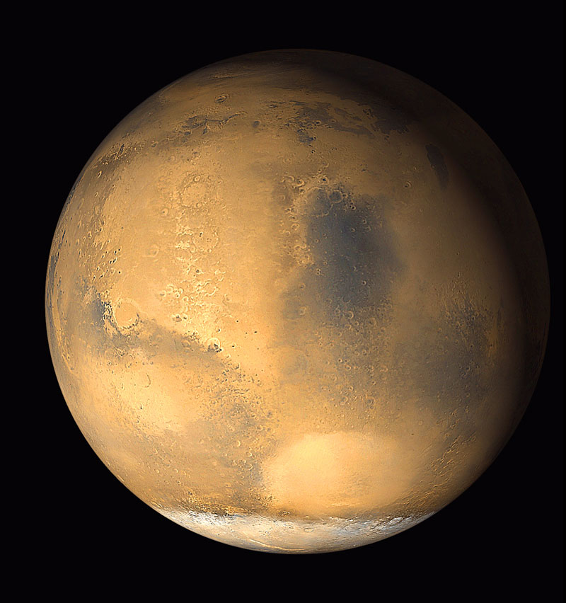 Normal view of Mars with mountains, craters and canyons visible from space.