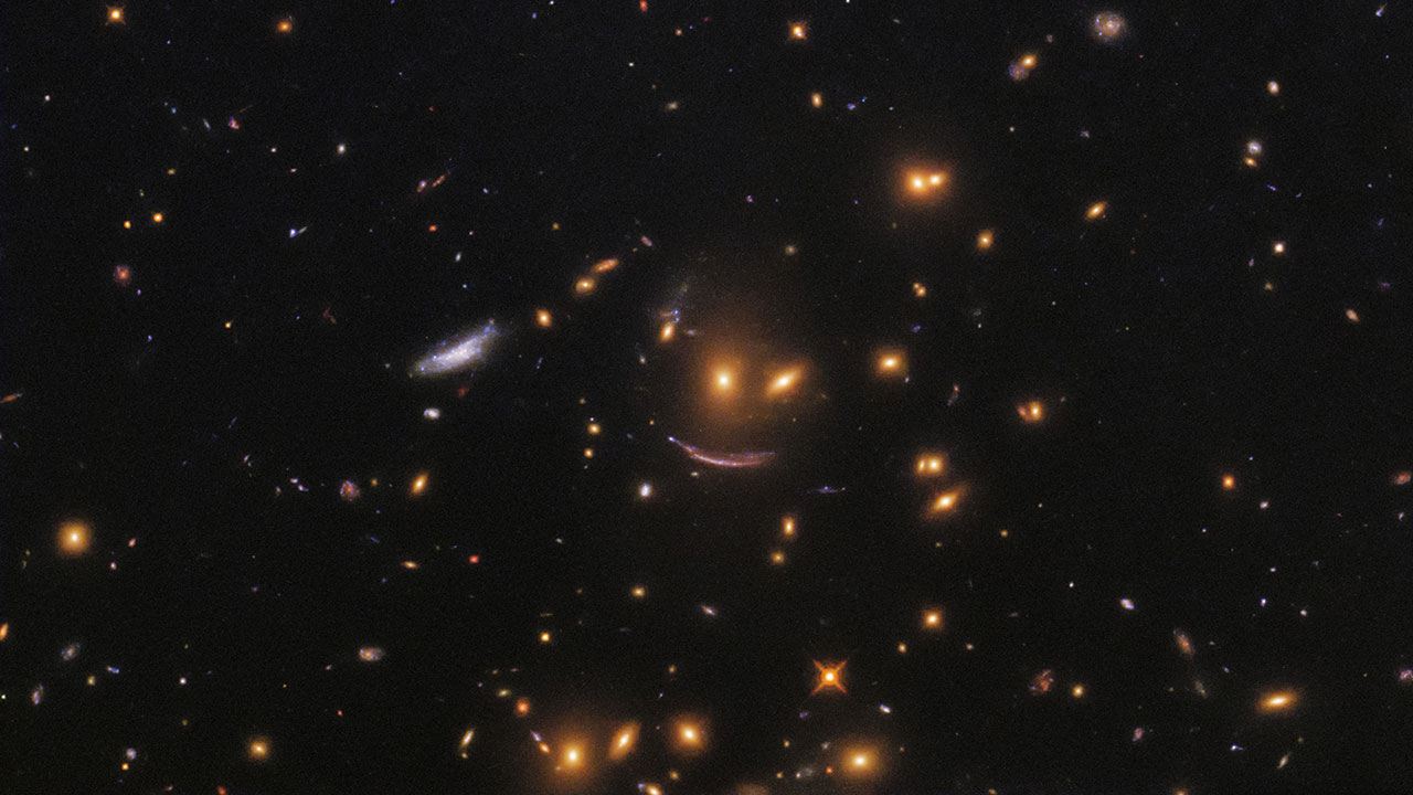 Three galaxies form a smiling fact.