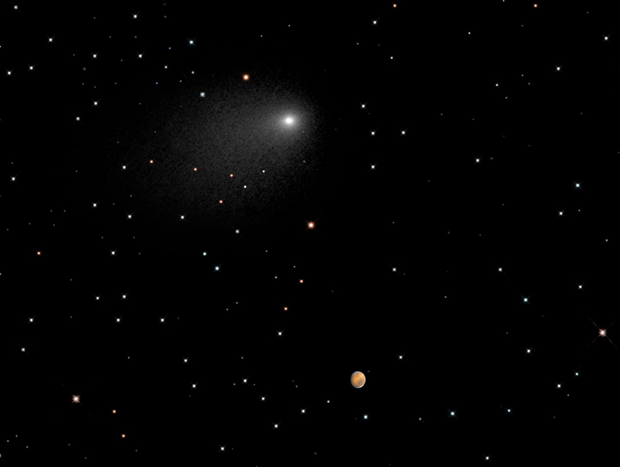 Comet and Mars close together against a backdrop of stars.