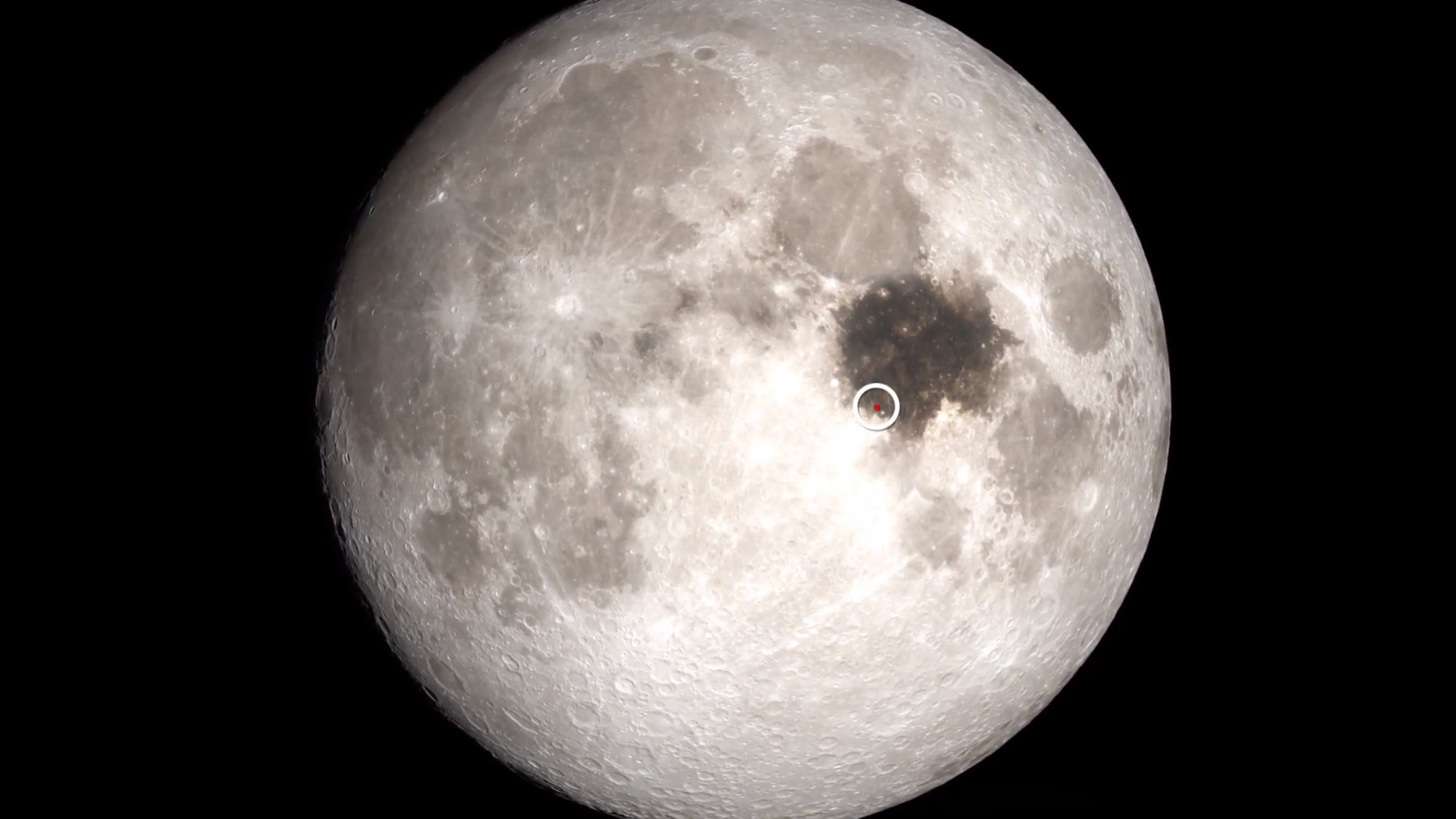 Picture of Moon with Sea of Tranquility and Apollo 11 landing site marked.
