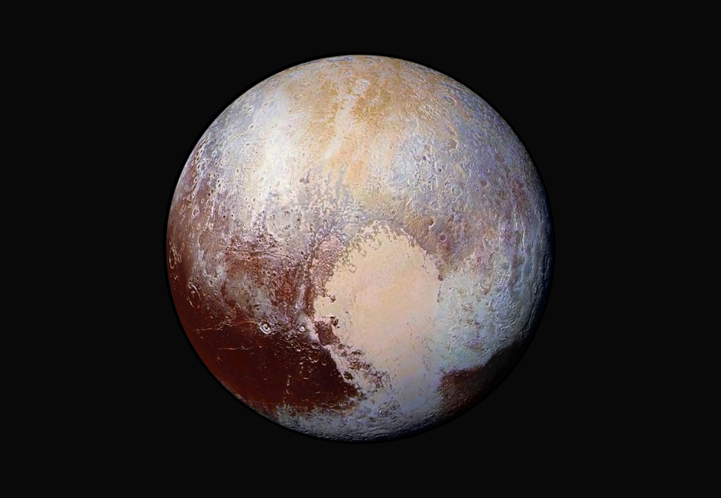 Enhanced view of Pluto revealing a heart-shaped region of glaciers.