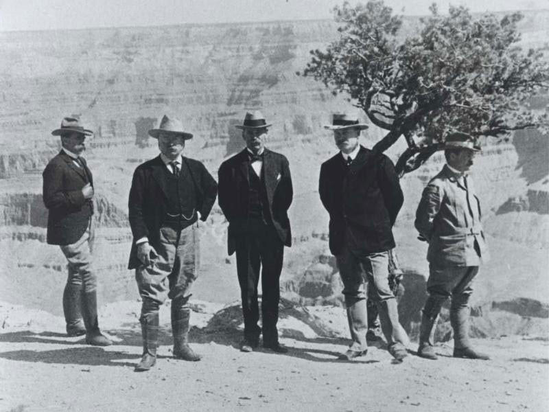 Five men, including President Theodore Roosevelt, pose in front of the Grand Canyon.