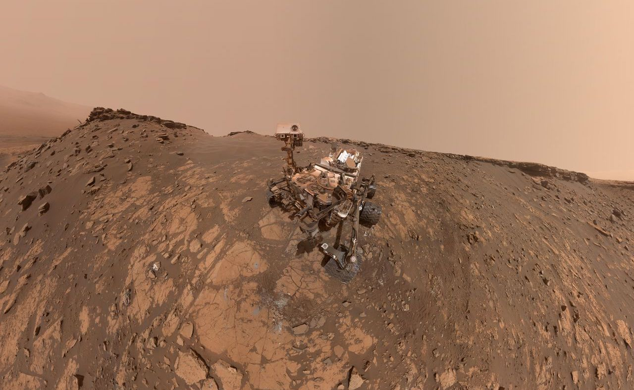 mars rover in rocky landscape