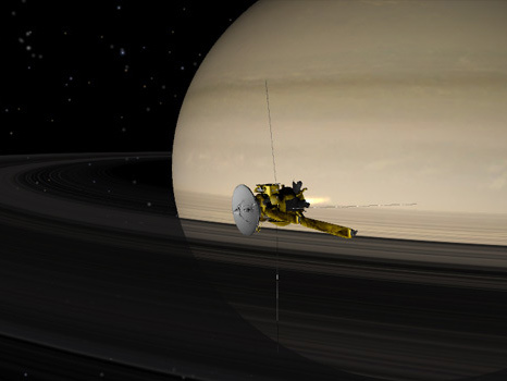 Image of Cassini spacecraft flying by Saturn