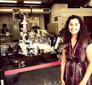 Anita standing in front of Curiosity model