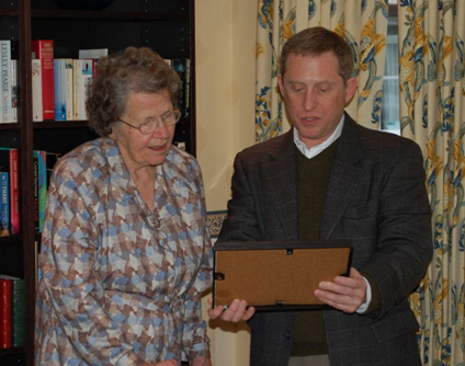 Alan Stern presents a plaque to Venetia Burney Phair