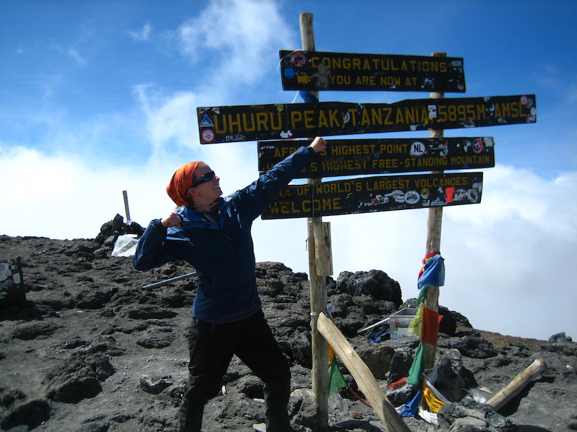 Photo of Morgan Cable on top of Mount Kilimanjaro.