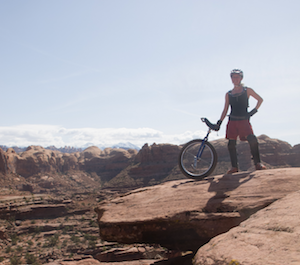 Photo of Morgan Cable in the desert of Moab, Utah, with a mountain unicycle.